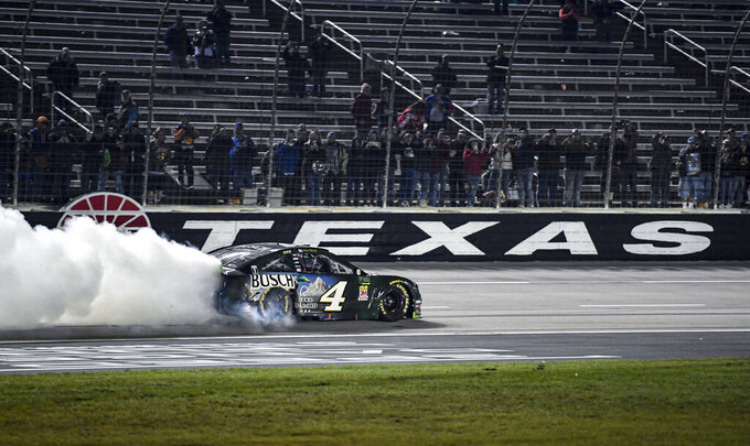 Kevin Harvick (4) celebrates after winning a NASCAR Cup Series auto race with a burnout at Texas Motor Speedway, Sunday, Nov. 3, 2019, in Fort Worth, Texas. (AP Photo/Larry Papke)