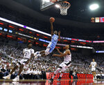 North Carolina guard Kenny Williams (24) goes in for a layup over the defense of Louisville forward Dwayne Sutton (24) during the first half of an NCAA college basketball game in Louisville, Ky., Saturday, Feb. 2, 2019. North Carolina won 79-69. (AP Photo/Timothy D. Easley)