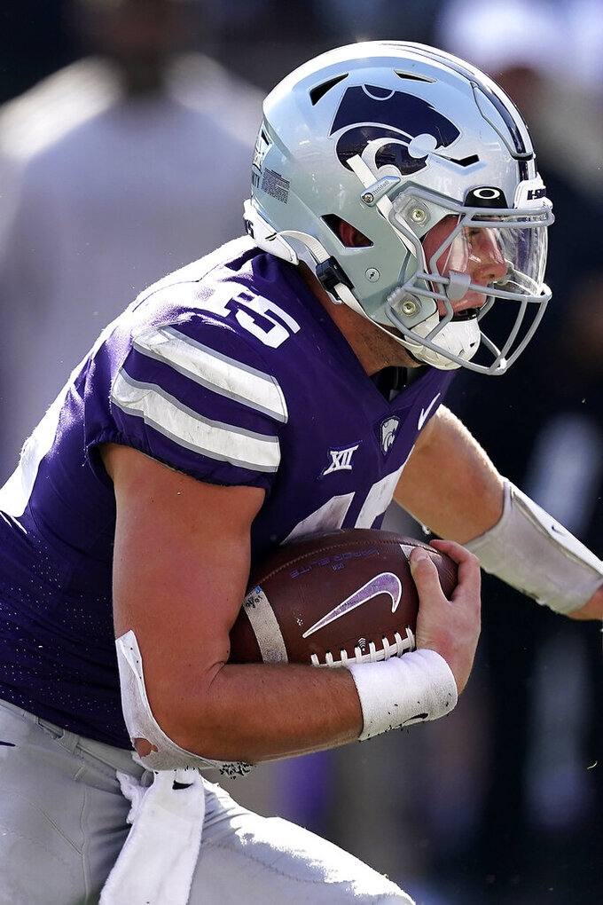 Kansas State quarterback Will Howard runs for a touchdown during the second half of an NCAA college football game against Nevada Saturday, Sept. 18, 2021, in Manhattan, Kan. (AP Photo/Charlie Riedel)