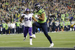 Seattle Seahawks' Rashaad Penny high steps into the end zone for a touchdown against the Minnesota Vikings during the second half of an NFL football game, Monday, Dec. 2, 2019, in Seattle. (AP Photo/John Froschauer)