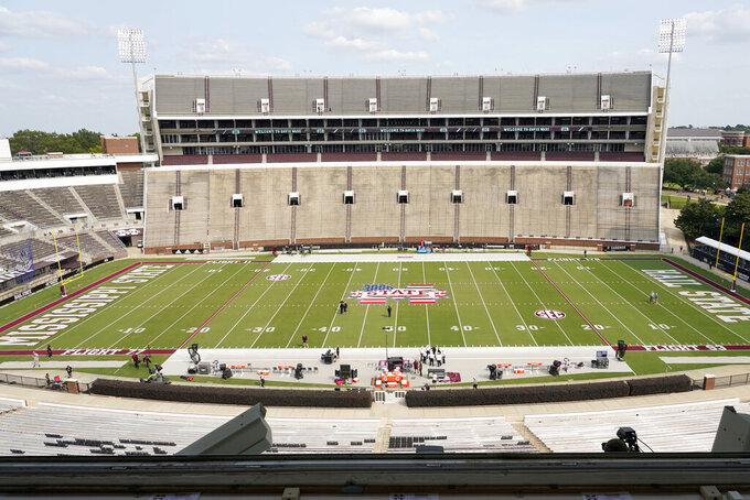 As part of the 9/11 commemoration, part of a U.S. flag is painted in Mississippi State's emblem midfield and the different flight numbers of the airliners that were crashed on that day, at Davis Wade Stadium at Scott Field in Starkville, Miss.,. Saturday, Sept. 11, 2021, for the NCAA college football game between North Carolina State and Mississippi State. (AP Photo/Rogelio V. Solis)