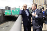 U.S. Rep.  Josh Gottheimer (NJ-5), right, and and Rep. Bill Pascrell (NJ-9) talk about traffic on the George Washington Bridge following a news conference near the bridge talking about the congressmen's plan to fight back against New York City's proposed congestion tax on New Jersey commuters, Wednesday, April 17, 2019, in Fort Lee, N.J. The congressmen announced legislation they say will ensure New Jersey motorists, who already pay up to $15 for bridge or tunnel tolls, won't be charged twice. New York's legislature approved a conceptual plan this month. that will allocate revenue to fix the city's mass transit system. New York would become the first American city to use so-called congestion pricing to reduce gridlock and fund mass transit improvements. (AP Photo/Julio Cortez)