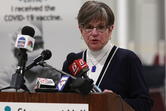 Kansas Gov. Laura Kelly answers questions about the state's plans to accelerate its distribution of COVID-19 vaccines during a news conference following a tour of a mass inoculation clinic, Monday, March 15, 2021, at the Stormont Vail Events Center in Topeka, Kan. The state is trying to meet President Joe Biden's goal of having all adult residents eligible for inoculations by May 1, 2021. (AP Photo/John Hanna)