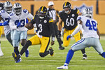 Pittsburgh Steelers quarterback Dwayne Haskins (3) rushes against the Dallas Cowboys during the first half of the Pro Football Hall of Fame NFL preseason game Thursday, Aug. 5, 2021, in Canton, Ohio. (AP Photo/David Richard)