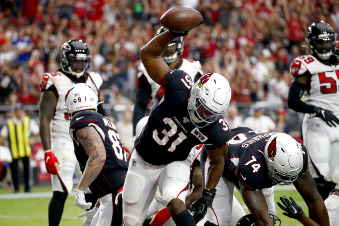 Arizona Cardinals running back David Johnson (31) celebrates his touchdown against the Atlanta Falcons during the first half of an NFL football game, Sunday, Oct. 13, 2019, in Glendale, Ariz. (AP Photo/Ross D. Franklin)