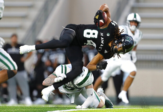 Hawaii wide receiver Nick Mardner (84) is upended by a Portland State defender during the first half of an NCAA college football game Saturday, Sept. 4, 2021, in Honolulu. (AP Photo/Darryl Oumi)