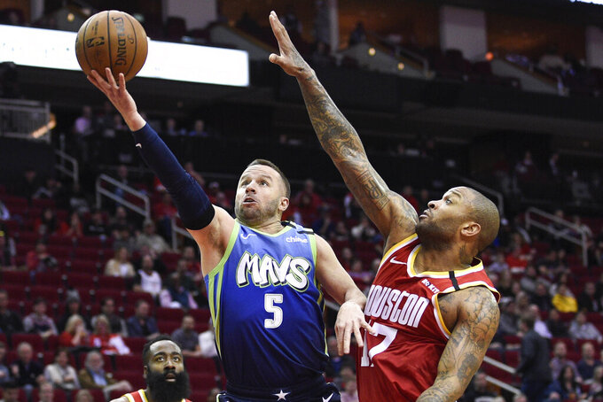 FILE - Dallas Mavericks guard J.J. Barea (5) drives to the basket as Houston Rockets forward P.J. Tucker defends during the first half of an NBA basketball game in Houston, in this Friday, Jan. 31, 2020, in file photo. The Dallas Mavericks released J.J. Barea on Thursday, Dec. 10, 2020, turning loose the last piece of the franchise's 2011 championship team to give the veteran guard a chance to continue his playing career. (AP Photo/Eric Christian Smith, File)