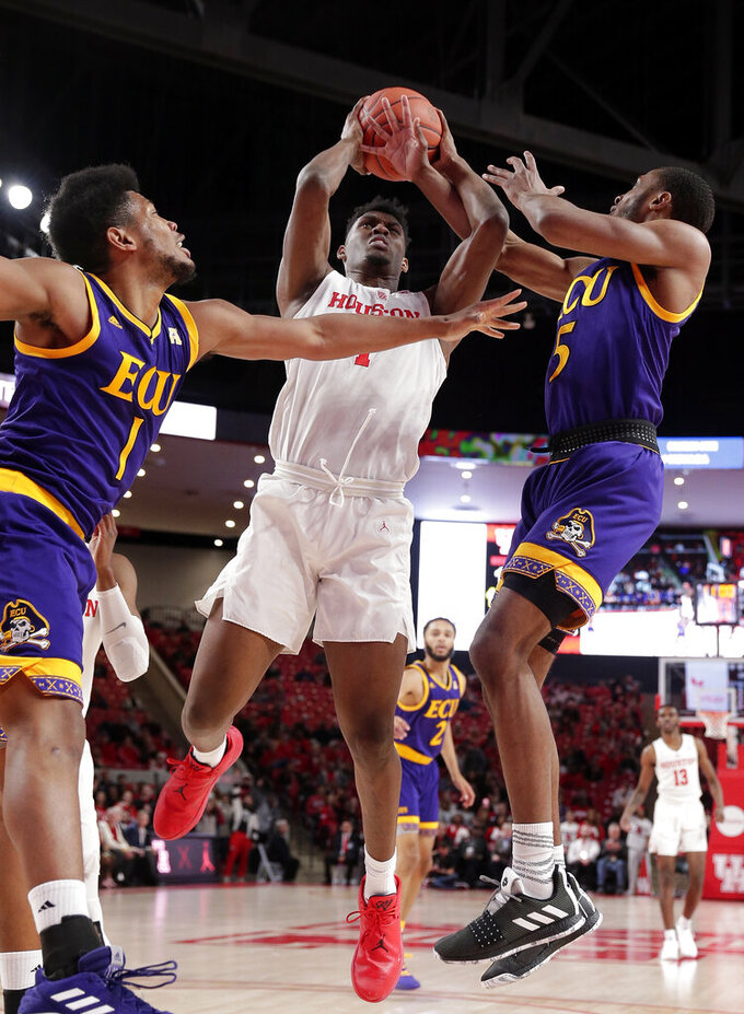 Houston center Chris Harris Jr. (1) pulls in a rebound between East Carolina forward Jayden Gardner (1) and guard Tyler Foster (5) during the first half of an NCAA college basketball game Wednesday, Jan. 23, 2019, in Houston. (AP Photo/Michael Wyke)