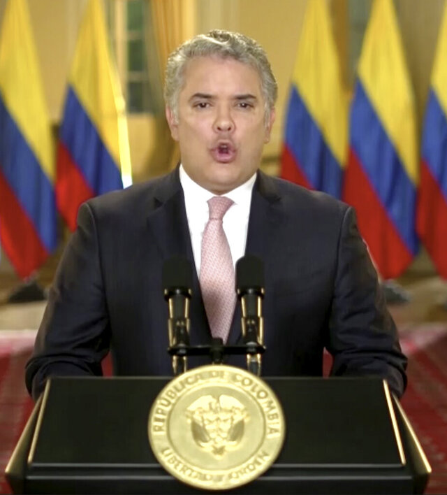 In this image made from UNTV video, Colombia President Iván Duque Márquez speaks in a pre-recorded message which was played during the 75th session of the United Nations General Assembly, Tuesday, Sept. 22, 2020, at U.N. headquarters in New York. The U.N.'s first virtual meeting of world leaders started Tuesday with pre-recorded speeches from some of the planet's biggest powers, kept at home by the coronavirus pandemic that will likely be a dominant theme at their video gathering this year. (UNTV via AP)