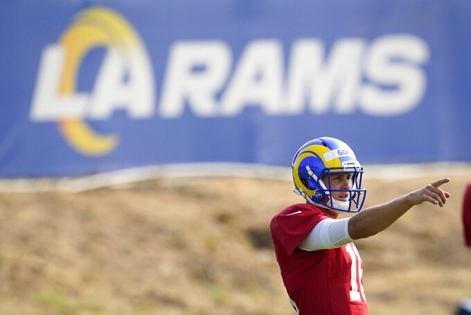 Los Angeles Rams quarterback Jared Goff signals during NFL football training camp, Tuesday, Aug. 18, 2020, in Thousand Oaks, Calif. (AP Photo/Marcio Jose Sanchez)