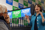 Arnold Zar-Kessler, left, listens to Democratic presidential candidate Sen. Amy Klobuchar, D-Minn., as she speaks at a campaign event, Tuesday, Dec. 3, 2019, in Milford, N.H. (AP Photo/Elise Amendola)
