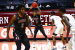 New Mexico State's guard Evan Gilyard II (3) looks to pass the ball during the first half of the team's NCAA college basketball game against Grand Canyon for the championship of the Western Athletic Conference men's tournament Saturday, March 13, 2021, in Las Vegas. (AP Photo/Chase Stevens)