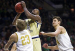 Georgia Tech's Moses Wright (5) goes up for a shot between Notre Dame's Dane Goodwin (23) and Nate Laszewski (14) during the first half of an NCAA college basketball game Saturday, Feb. 1, 2020, in South Bend, Ind. (AP Photo/Robert Franklin)