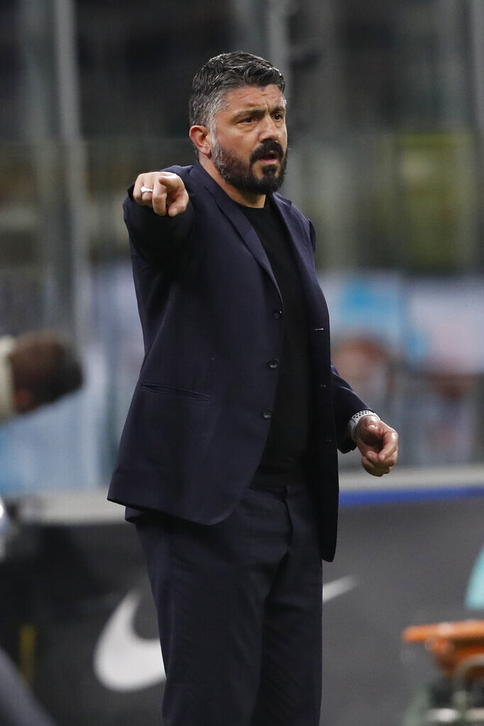 FILE - In this Feb. 12, 2020 file photo, Napoli's head coach Gennaro Gattuso gives instructions to his players during an Italian Cup soccer match between Inter Milan and Napoli at the San Siro stadium, in Milan, Italy. With Inter, Juventus and Milan -- plus Napoli -- all in action when Italian soccer restarts with the Italian Cup semifinals this week, the effects of the pandemic will still be fresh in the minds of players, coaches and club executives. Napoli hosts Inter on Saturday, June 13, 2020. (AP Photo/Antonio Calanni, file)
