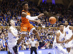 Miami's Chris Lykes passes while Duke's Alex O'Connell, left, and Tre Jones (3) defend during the first half of an NCAA college basketball game in Durham, N.C., Saturday, March 2, 2019. (AP Photo/Gerry Broome)