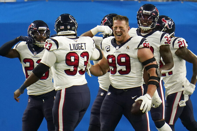 Houston Texans defensive end J.J. Watt (99) celebrates his interception for a touchdown during the first half of an NFL football game against the Detroit Lions, Thursday, Nov. 26, 2020, in Detroit. (AP Photo/Paul Sancya)