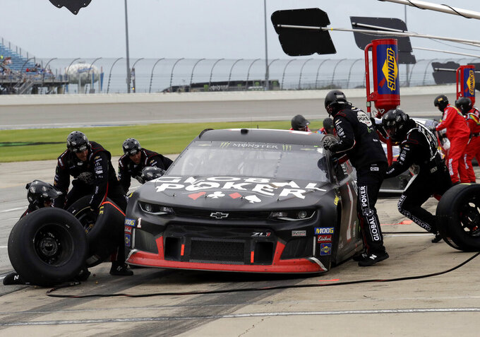 Kurt Busch makes a pit stop during a NASCAR Cup Series auto race at Chicagoland Speedway in Joliet, Ill., Sunday, June 30, 2019. (AP Photo/Nam Y. Huh)