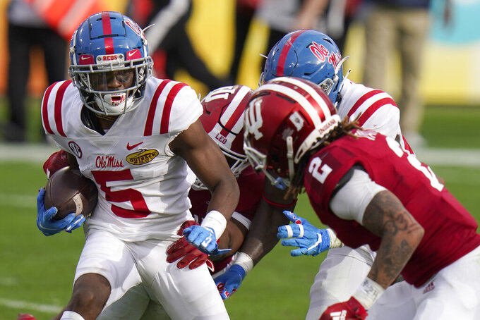 Mississippi wide receiver Dannis Jackson eludes Indiana defensive back Reese Taylor (2) during the second half of the Outback Bowl NCAA college football game Saturday, Jan. 2, 2021, in Tampa, Fla. (AP Photo/Chris O'Meara)