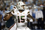 Miami's Jarren Williams (15) looks to pass against North Carolina during the first quarter of an NCAA college football game in Chapel Hill, N.C., Saturday, Sept. 7, 2019. (AP Photo/Chris Seward)