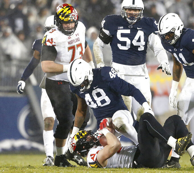 Penn State's Shareef Miller (48) drops Maryland's Avery Edwatds (82) for a loss during the second half of an NCAA college football game in State College, Pa., Saturday, Nov. 24, 2018. Penn State won 38-3. (AP Photo/Chris Knight)