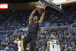 San Diego State forward Matt Mitchell (11) dunks the ball during the first half of an NCAA college basketball game against Nevada in Reno, Nev., Saturday, Feb. 29, 2020. (AP Photo/Tom R. Smedes)