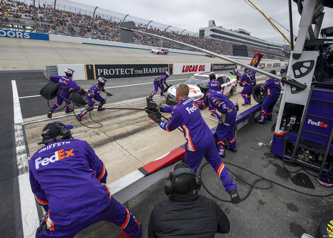 Denny Hamlin makes a pit stop during the NASCAR Cup Series playoff auto race Sunday, Oct. 6, 2019, at Dover International Speedway in Dover, Del. (AP Photo/Jason Minto)