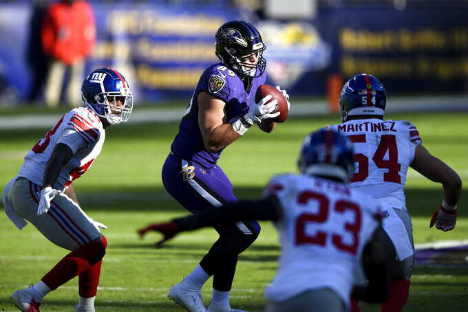 Baltimore Ravens tight end Mark Andrews, center, makes a catch as New York Giants linebacker Tae Crowder (48), inside linebacker Blake Martinez (54) and free safety Logan Ryan (23) move in to tackle him during the first half of an NFL football game, Sunday, Dec. 27, 2020, in Baltimore. (AP Photo/Nick Wass)