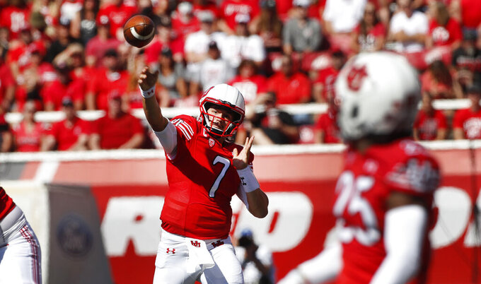 Utah quarterback Cameron Rising (7) passes the ball to Utah wide receiver Jaylen Dixon (25) in the second half, of an NCAA college football game against Washington State Saturday, Sept. 25, 2021, in Salt Lake City. (AP Photo/George Frey)