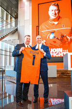 Incoming Illinois football coach Bret Bielema, left, is accompanied by Josh Whitman, Director of Athletics at Smith Football Center in Champaign, Ill., as he is introduced as the new football coach at U of I in this undated photo. Bielema said Monday, Dec. 21, 2020, he hopes to have a coaching staff in place by early January 2021, and is already concentrating on homegrown recruiting. (Michael Glasgow/University of Illinois Athletics via AP)
