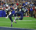 FILE - In this Feb. 1, 2015, file photo, New England Patriots cornerback Malcolm Butler (21) intercepts a pass intended for Seattle Seahawks wide receiver Ricardo Lockette during the NFL Super Bowl XLIX football game in Glendale, Ariz. The biggest moment in Malcolm Butler's career happened right here at State Farm Stadium, when the rookie cornerback stepped in front of a Seattle Seahawks receiver at the goalline, intercepted a Russell Wilson pass, and secured a stunning Super Bowl XLIX victory for the New England Patriots. That play was about 6 1/2 years ago. Butler — who is entering his first season with the Arizona Cardinals — is finding out that's an eternity in NFL time.(AP Photo/Kathy Willens, File)