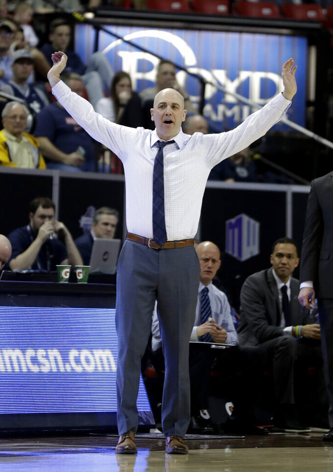 Utah State coach Craig Smith gestures during the second half of the team's NCAA college basketball game against Fresno State in the Mountain West Conference men's tournament Friday, March 15, 2019, in Las Vegas. (AP Photo/Isaac Brekken)