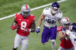 Ohio State running back Trey Sermon (8) runs for the end zone to score past Northwestern linebacker Blake Gallagher (51) during the second half of the Big Ten championship NCAA college football game, Saturday, Dec. 19, 2020, in Indianapolis. (AP Photo/Darron Cummings)