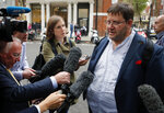 French fisherman Dimitri Rogoff speaks to the media as leaders meet in London, Wednesday, Sept. 5, 2018. The meeting focuses on the so called