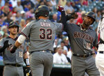 Arizona Diamondbacks first baseman Kevin Cron (32) is greeted by Adam Jones (10) after a three-run home run in the second inning of a baseball game against the Texas Rangers Wednesday, July 17, 2019, in Arlington, Texas. (AP Photo/Richard W. Rodriguez)