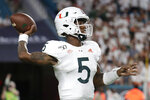 Miami quarterback N'Kosi Perry (5) throws a pass during the second half of the team's NCAA college football game against Virginia, Friday, Oct. 11, 2019, in Miami Gardens, Fla. Miami won 17-9. (AP Photo/Lynne Sladky)