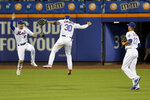 New York Mets outfielders Jeff McNeil, left, Michael Conforto, center, and Aaron Altherr celebrate after a baseball game against the Washington Nationals, Saturday, Aug. 10, 2019, in New York. (AP Photo/Seth Wenig)