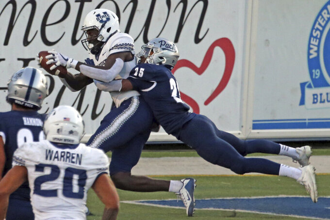 Utah State's Justn McGriff (10) catches a touchdown pass from Jason Shelley in front of Nevada's AJ King (25) during the first half of an NCAA college football game Thursday, Nov. 5, 2020, in Reno, Nev. (AP Photo/Lance Iversen)