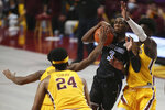 Saint Louis' Javonte Perkins (3) tries to maintain control of the ball against Minnesota's Isaiah Ihnen (35) and Jamal Mashburn Jr. (4) during an NCAA college basketball game, Sunday, Dec. 20, 2020, in Minneapolis. Minnesota won 90-82. (AP Photo/Stacy Bengs)