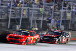 Justin Allgaier (7) leads Tyler Reddick (2) during the NASCAR Xfinity Series auto race Friday, Aug. 16, 2019, in Bristol, Tenn. (AP Photo/Wade Payne)