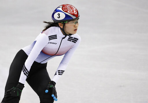 FILE - In this Feb. 10, 2018, file photo, Shim Suk-hee of South Korea reacts after the ladies' 3000 meters short-track speedskating relay in the Gangneung Ice Arena at the 2018 Winter Olympics in Gangneung, South Korea. Two-time Olympic champion Shim has been cut from South Korea's short track speedskating team after a reported text message exchange that suggested she may have intentionally tripped a teammate during the 2018 Winter Games. (AP Photo/Bernat Armangue, File)