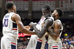 Connecticut's Akok Akok, center, laughs as he is picked up by teammates Brendan Adams, left, and Christian Vital, right, in the second half of an NCAA college basketball game against Temple, Wednesday, Jan. 29, 2020, in Storrs, Conn. (AP Photo/Jessica Hill)