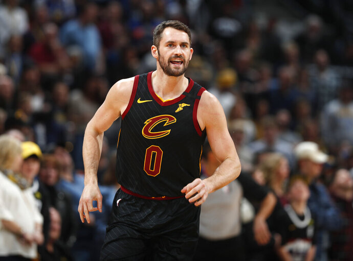 FILE - In this Jan. 11, 2020, file photo, Cleveland Cavaliers forward Kevin Love heads up the court after making a 3-point basket against the Denver Nuggets during the first half of an NBA basketball game in Denver. Love received the Arthur Ashe Award for Courage at the ESPY Awards on Sunday, June 21, 2020, for sparking a national conversation about mental health. (AP Photo/David Zalubowski, File)