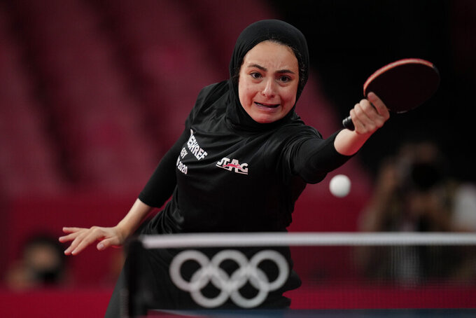 Egypt's Dina Meshref competes during the table tennis women's singles second round match against Poland's Natalia Partyka at the 2020 Summer Olympics, Sunday, July 25, 2021, in Tokyo. (AP Photo/Kin Cheung)