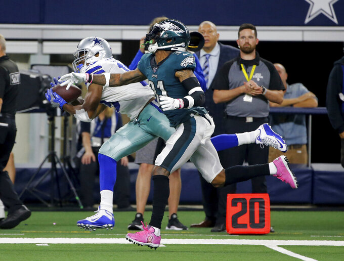 Dallas Cowboys wide receiver Amari Cooper (19) catches a pass along the sideline in front of Philadelphia Eagles' Jalen Mills (31) in the second half of an NFL football game in Arlington, Texas, Sunday, Oct. 20, 2019. (AP Photo/Michael Ainsworth)