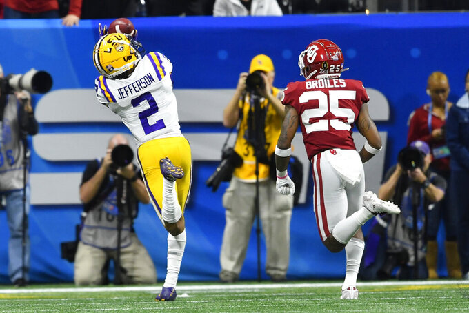 LSU wide receiver Justin Jefferson (2) prepares for a touchdown catch against Oklahoma safety Justin Broiles (25) during the first half of the Peach Bowl NCAA semifinal college football playoff game, Saturday, Dec. 28, 2019, in Atlanta. (AP Photo/John Amis)