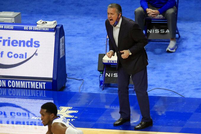 Kentucky coach John Calipari yells to the team during the first half of an NCAA college basketball game against Alabama in Lexington, Ky., Tuesday, Jan. 12, 2021. (AP Photo/James Crisp)