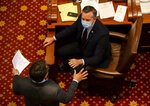 Illinois State Sen. Andy Manar, D-Bunker Hill, talks with a colleague during debate on SB1863, a bill dealing with vote by mail and other changes for the 2020 election, on the floor of the Illinois Senate during session at the Illinois State Capitol, Friday, May 22, 2020, in Springfield, Ill. (Justin L. Fowler/The State Journal-Register via AP, Pool)