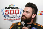 Corey LaJoie listens to a question from a reporter during NASCAR Daytona 500 auto racing media day at Daytona International Speedway, Wednesday, Feb. 13, 2019, in Daytona Beach, Fla. (AP Photo/John Raoux)