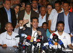 Venezuelan Congress President Juan Guaido, an opposition leader who has declared himself interim president, gives a news conference at the end of his meeting with leaders of public employee unions in Caracas, Venezuela, Tuesday, March 5, 2019. Guaido said police officials were among those at the meeting with state workers who rely heavily on government subsidies to get by in a country suffering from hyperinflation and shortages of food and other necessities. (AP Photo/Fernando Llano)