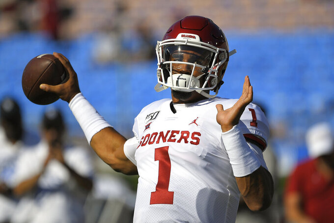 Oklahoma quarterback Jalen Hurts warms up for the team's NCAA college football game against UCLA on Saturday, Sept. 14, 2019, in Pasadena, Calif. (AP Photo/Mark J. Terrill)